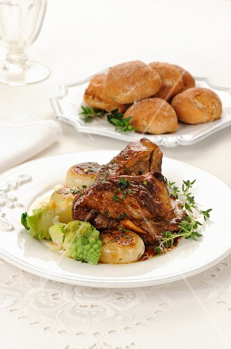 Roast lamb with onions and Romanesco broccoli