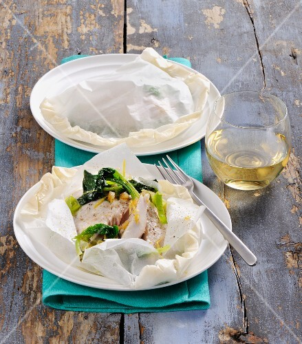 Fish with vegetables in parchment paper