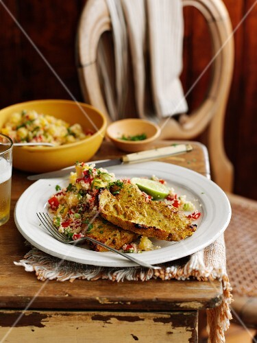 Pork steaks with curry, fruit and couscous salad