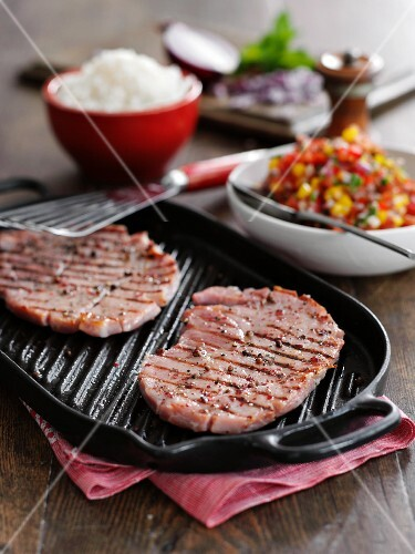 Grilled gammon steaks with salsa and rice