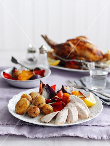 Grilled chicken with potatoes and a pepper medley