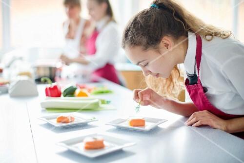 A grammar school student cooking in a food technology class
