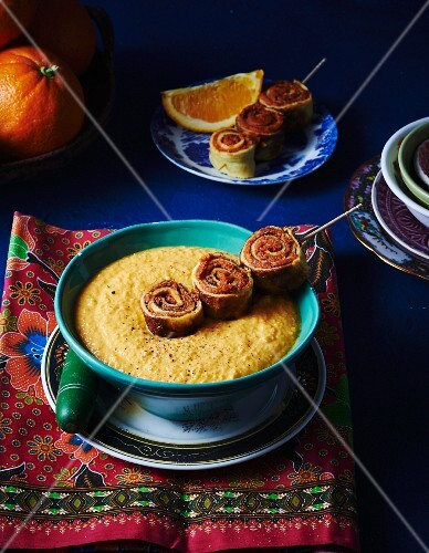 Orange and carrot soup with pancake rolls