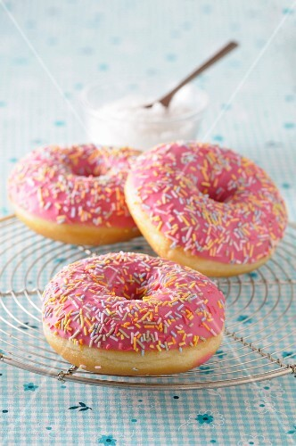 Pink glazed doughnuts with sugar sprinkles