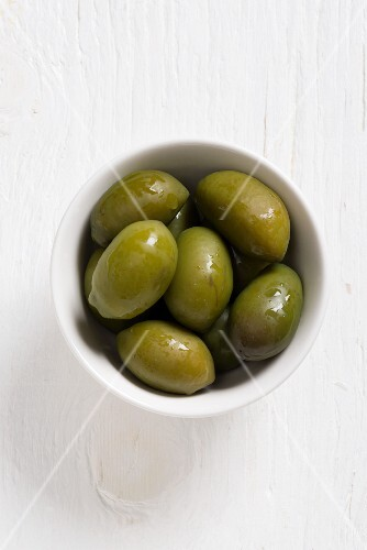 Bella di Cerignola olives in a white bowl