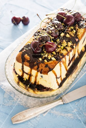 No-bake cake with cherries, pistachio nuts and chocolate sauce