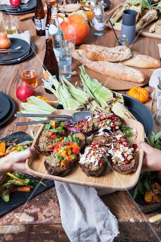 Roasted stuffed aubergines with lentil and coconut curry