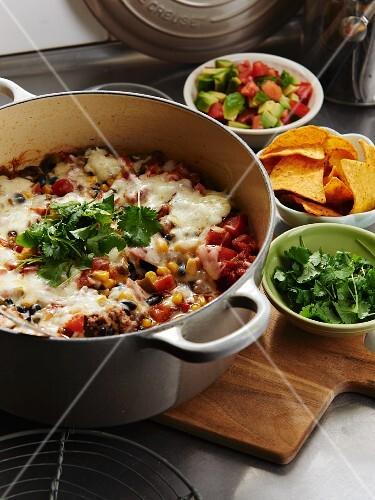 Burrito gratin with cheese and nachos