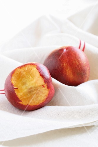 Nectarines, one with a bite taken out