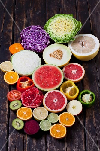 Various types of fruit and vegetables, halved
