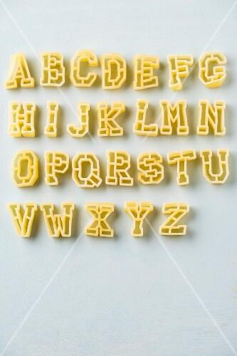 Alphabet pasta on a white surface
