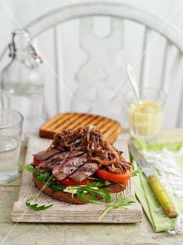 A steak and onion sandwich