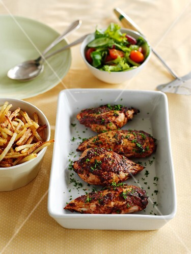 Tomato and basil chicken with chips and salad