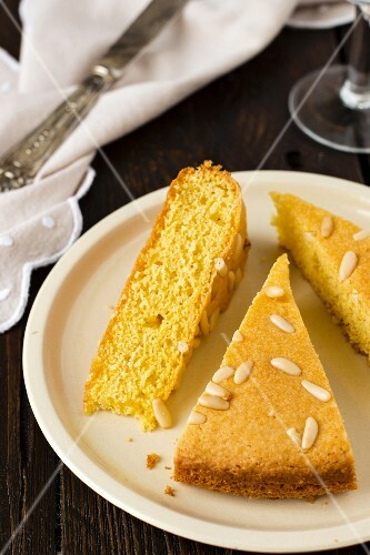 Three slices of pine nut cake on a plate
