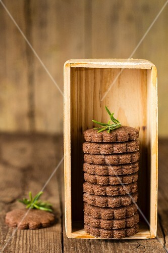 Chocolate biscuits stacked in a wooden box