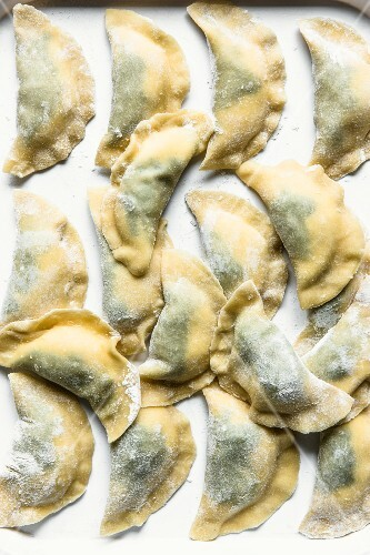 Homemade ravioli filled with spinach and ricotta