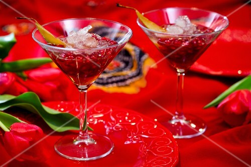 Two cocktails with pomegranate seeds