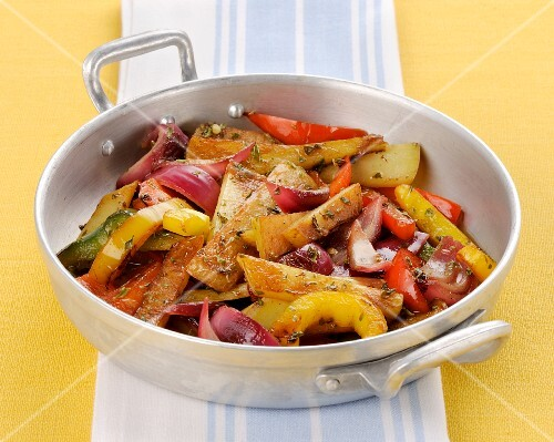 Colourful fried vegetables with oregano