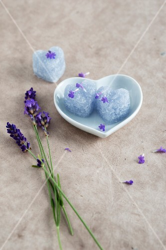 Homemade heart-shaped lavender sugar in a heart-shaped dish