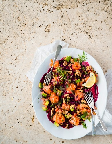 Beetroot carpaccio with avocado salsa, salmon and walnuts