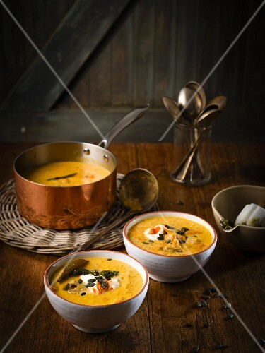 Pumpkin soup with smoked peppers, pumpkin seeds and Sriracha cream