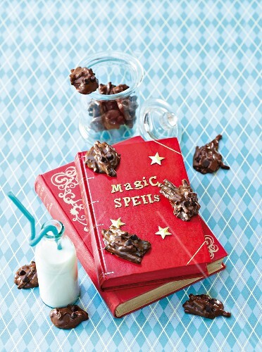 Chocolate beetles on a book of magic spells