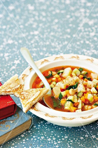 Colourful vegetable soup with butterfly toast