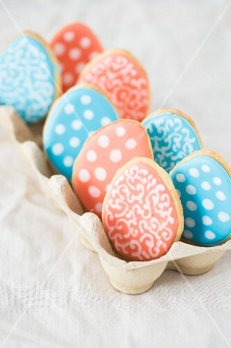 Colourful Easter egg biscuits in an egg box