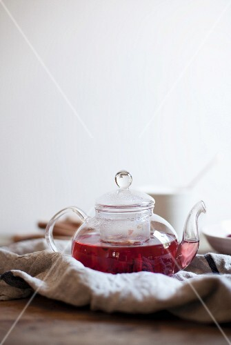 Fruit tea in a glass teapot