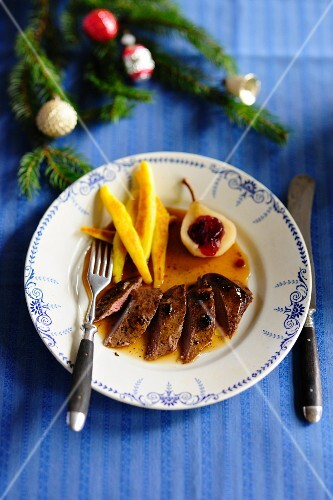 Saddle of venison with potato orzo pasta and lingonberry pears for Christmas