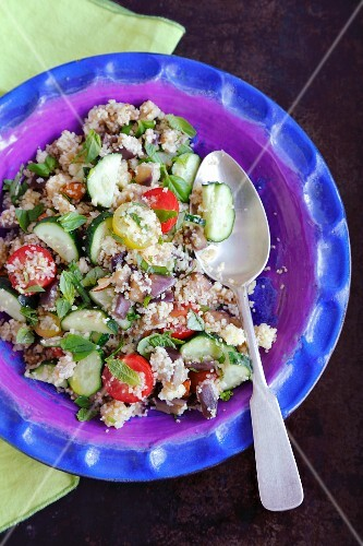 Couscous salad with aubergine, cherry tomatoes, cucumber and herbs