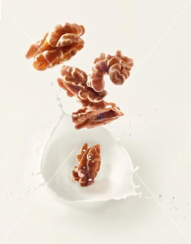 Walnuts falling into walnut milk