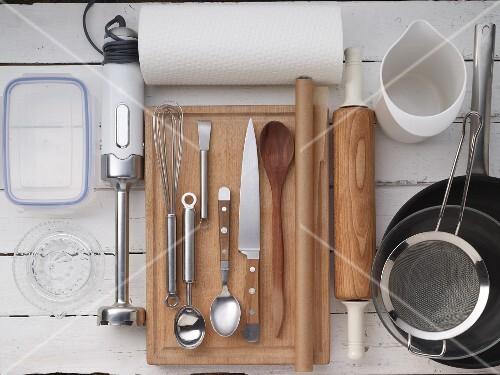 Kitchen utensils for making an ice cream dessert with berries