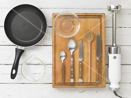 Kitchen utensils: a pan, cutlery, a knife and a hand blender