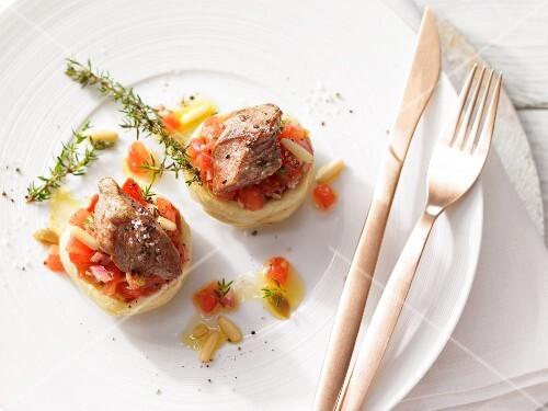 Stuffed artichoke hearts with fried lamb fillet