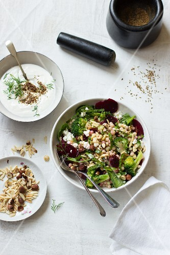 Ptitim salad with broccoli, beetroot, almonds, olives and feta cheese