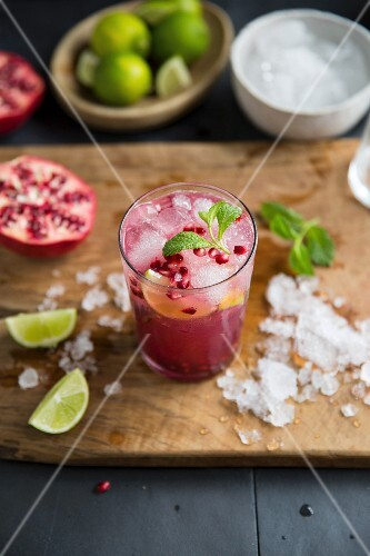 A pomegranate mojito with crushed ice