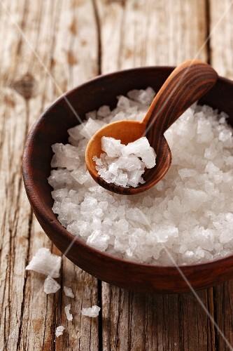 Coarse sea salt in a small wooden bowl