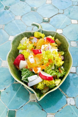 Potato salad with radishes, carrots and feta cheese