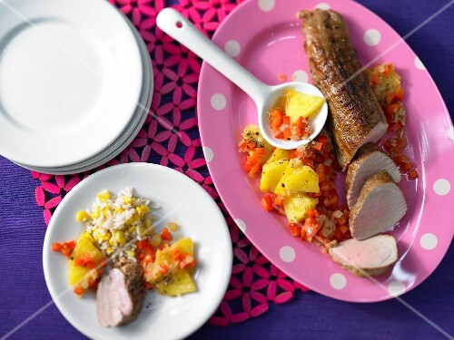 Roasted pork fillet on a paper and pineapple medley