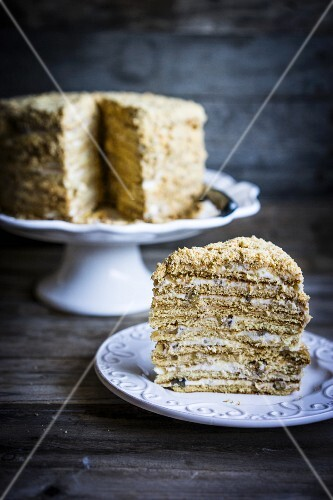 Honey cake with sour cream and walnuts
