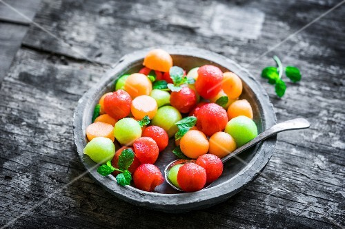 A bowl of colourful melon balls