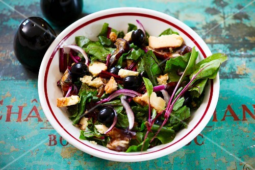 A salad made with beetroot leaves and smoked cheese