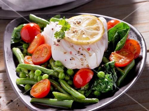 Cod fillet on a bed of vegetables