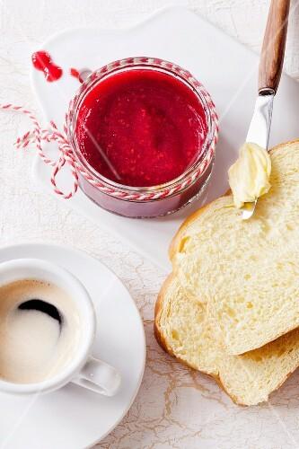Breakfast with espresso, brioche and raspberry jam