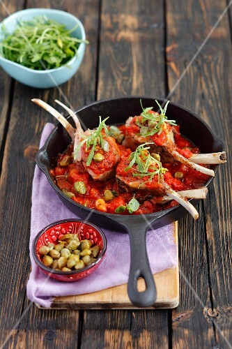 Lamb chops with a tomato and caper sauce