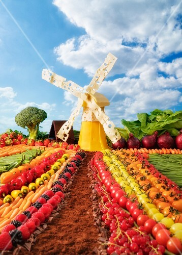 A Dutch landscape made from fruit and vegetables with a cheese windmill