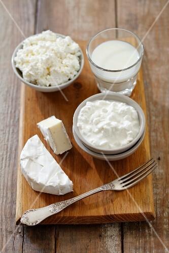 An arrangement of soft cheese, yoghurt, milk and quark