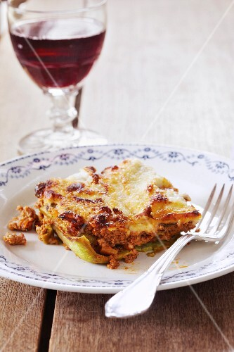 A portion of lasagne with minced meat and béchamel sauce