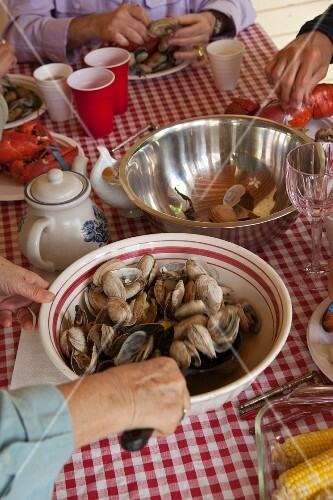 A woman serving steamed Ipswich clams